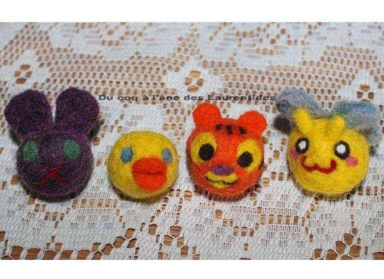 balle de laine en forme d'animaux (lapin mauve, canard, tigre et papillon)